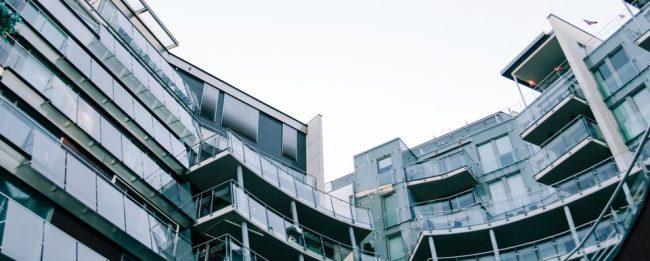 Modern geometric glass building with balconies