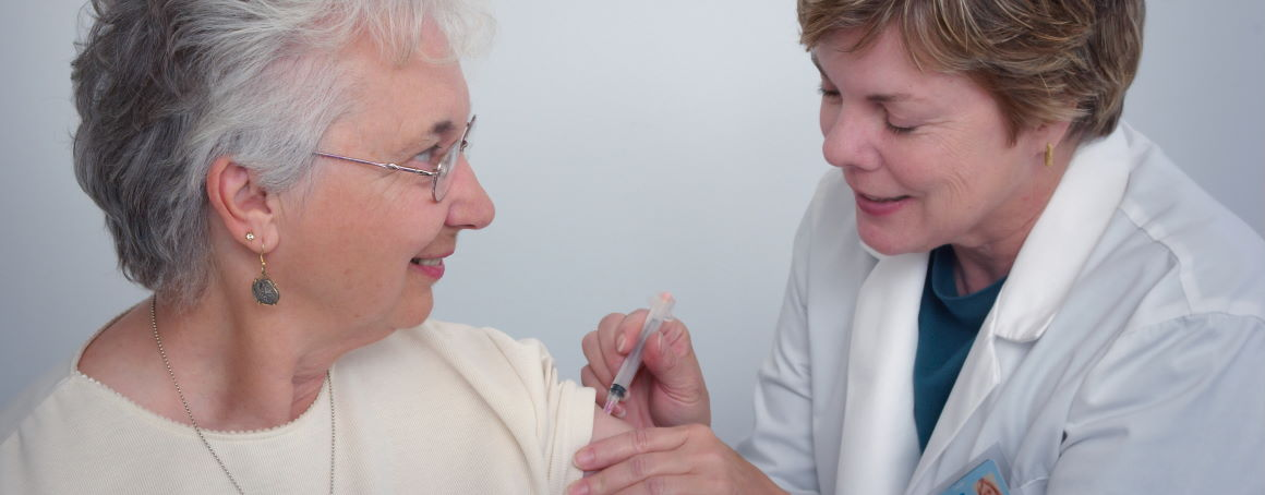 A patient being administered a vaccine by a doctor