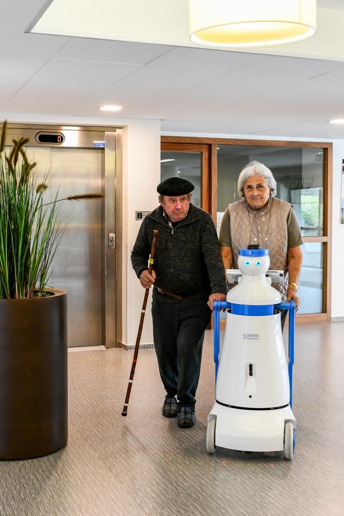 KOMPAÏ robot assisting older persons during a walk in nursing home